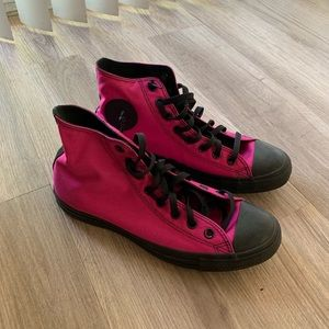 Black and pink high top converse